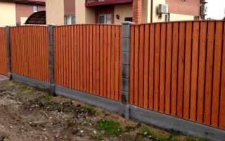 Забор из планкена лиственницы доски и штакетника
