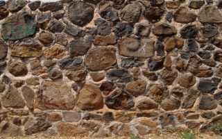 Забор из камня: строительство, как сделать своими руками
