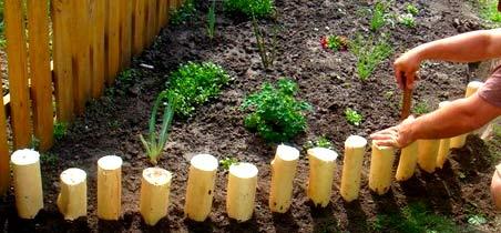 деревянная ограда для клумбы